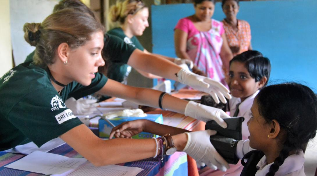 A group of teenagers do basic health checks under supervision during their medical internship in Sri Lanka.